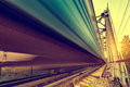 Highspeed train moves fast on the bridge at sunsset Royalty Free Stock Image