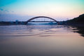 Highway arch bridge at dusk Royalty Free Stock Photography