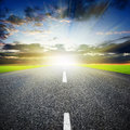 Highway asphalted over sunset sky background Stock Photos