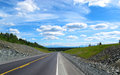 Highway in the blue sky alaska Royalty Free Stock Photography