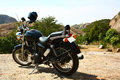 Highway cruiser on rough rocky terrain a cruises royal enfield thunderbird biks a hill top Stock Photos