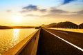 Highway at dusk the valley the lake a curve of the Royalty Free Stock Photography