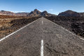 Highway through a lava field scenic view of receding on tenerife canary islands spain Stock Photography
