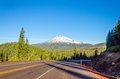 Highway and mount bachelor curving with a dramatic view of mt beautiful green pine tree forest near bend oregon Royalty Free Stock Photography