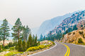 Highway through mountains scenic view of bending receding mountainous landscape Stock Image
