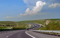 Sun Highway winding through the green hills - Romania Royalty Free Stock Photo