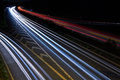 Highway on the night propelled at a long exposure light trails produce cars with their headlights Royalty Free Stock Image