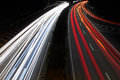 Highway on the night propelled at a long exposure light trails produce cars with their headlights Royalty Free Stock Photography