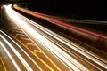 Highway on the night propelled at a long exposure light trails produce cars with their headlights Royalty Free Stock Images