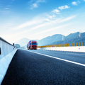 Highway and red truck Royalty Free Stock Photo