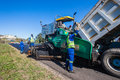 Highway road surfacing asphalt machines construction team laying new tar surface to local outside durban south africa close up Stock Photography