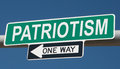 Highway sign with PATRIOTISM and ONE WAY