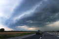 Highway and storm sky a with heavy clouds Royalty Free Stock Image