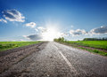 Highway and sunlight asphalted in the field Stock Photos