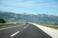 Highway to the mountains a single car on daily photo Royalty Free Stock Image