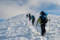 Hike in a winter mountain hikers Stock Photos