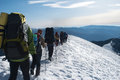 Hike in a winter mountain hikers Stock Photo