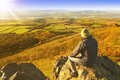 image photo : Hiker enjoying rest and landscape
