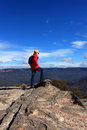 Hiker admiring mountain views a admires from flat rock wentworth falls australia Royalty Free Stock Photos
