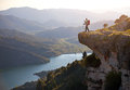Hiker with baby relaxing on cliff and enjoying valley view siurana spain Royalty Free Stock Photos