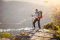 Hiker with baby standing on cliff Royalty Free Stock Photo