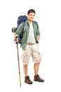 Hiker with backpack and hiking poles Royalty Free Stock Image