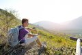 Hiker with backpack relaxing on a path of mountain young sitting Royalty Free Stock Images