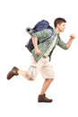 Hiker with backpack running Royalty Free Stock Image