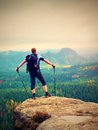 Hiker backpacker reaches the summit of mountain peak. Success, freedom and happiness Royalty Free Stock Photo