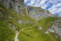 Hiker walking on ridge path