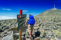 Hiker with big traveling rucksack looking forward on the mountai mountain trail adventure travel and discovery Stock Photo
