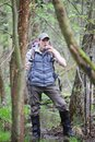 Hiker in the boggy forest taking break for drink Royalty Free Stock Photo