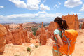 Hiker in bryce canyon hiking woman looking and enjoying view during her hike wearing hikers backpack national park Stock Photography