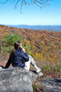Hiker/Cell Phone/Autumn Royalty Free Stock Photo