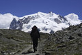 Hiker climbing monte rosa mountain massif located in the eastern part of the pennine alps switzerland Stock Photos