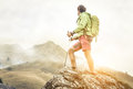 Hiker climbing on the mountains. Royalty Free Stock Photo