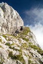 Hiker climbing the stone stairs in the mountains Royalty Free Stock Photo