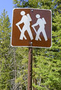 Hiker crossing sign in the mountains Royalty Free Stock Photo