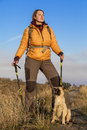 Hiker and dog female has break on her walk feeds her Royalty Free Stock Photography