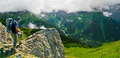 Hiker enjoys landscape on the top panorama Royalty Free Stock Photo