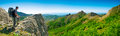 Hiker enjoys landscape on the top panorama Royalty Free Stock Images