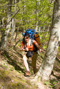 Hiker girl with backpack  in spring forest Royalty Free Stock Photography