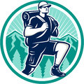 Hiker hiking mountain retro illustration of a walking striding facing front with trees and mountains in background set inside Royalty Free Stock Photo