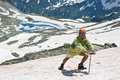 Hiker with ice-axe on snow. Royalty Free Stock Photo