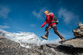 Hiker jumps in mountains himalaya Stock Image