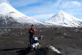 Hiker on kamchatka small antarctica glacier and snowy volcano at the background russia Stock Photography