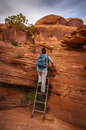 Hiker on the ladder female climbing metal a corona arch trail Royalty Free Stock Photos