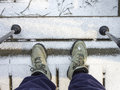 Hiker looking down at boots on stairs in snow with poles close up of from the s perspective covered bottom portion of included Royalty Free Stock Images