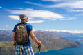 Hiker looking at the horizon in mountains Royalty Free Stock Photos