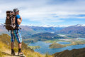 Hiker looking at the horizon in mountains on sunny day Royalty Free Stock Photography
